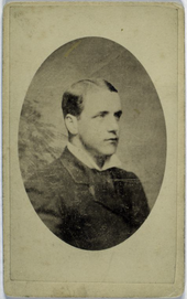 A portrait of a gentleman posing in a suit and facing slightly left.