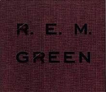 "A crimson cover with rough hewn texture that has ""GREEN"" and ""R.E.M."" debossed on it in black"