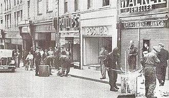 Aldershot riot (1945) - Cleaning up Union Street in Aldershot after the riot