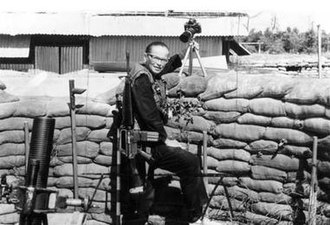 Dickey Chapelle - Chapelle at the Don Phuc command post on the Vietnamese-Cambodian border, 1964.