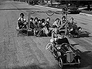 The gang races rich-kid Jerry Tucker in their makeshift fire engine in the 1934 short Hi'-Neighbor!