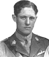 A portrait photograph of a young white man with dark hair, wearing a British military uniform