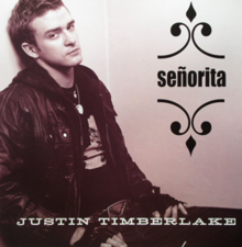 "A young man sitting, his back to the wall, facing to his right. He is wearing a T-shirt with a black jacket. The word ""Señorita"" is written in black bold font. In capitals, the name ""Justin Timberlake"" is written in white font."
