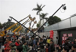Hong Kong Chief Executive election, 2012 - Media-hired cranes stooping over 5 and 7 York Road – Henry Tang's residence – following revelations of illegal structures there.