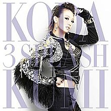"The artwork features a Japanese woman, posing in front of a camera with all-black clothing on. The words ""Koda Kumi"" and ""3 Splash"" are imprinted on the front."
