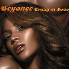 "Left side of the face of a brunette woman with soft make-up. Behind her, the chest of a naked man is visible. The words ""Beyoncé"" and ""Crazy in Love"" are written above her image."