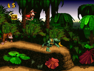 Donkey Kong (character) - A screenshot from the game, Donkey Kong Country. Donkey Kong is at the far left, following Diddy Kong as the player controls him.