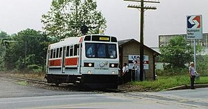 "Fox Chase Line - SEPTA performing a test run of the British BRE-Leyland Diesel railbuses at Huntingdon Valley Station, September 1985. Note brand new SEPTA ""lollipop"" station sign at right and ""Station for Lease"" sign on the now-demolished station shelter."