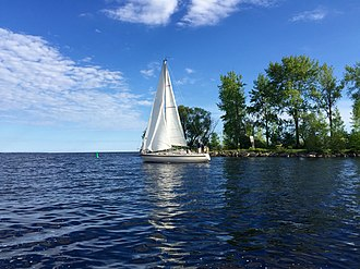 Escanaba, Michigan - Sailboat departing the yacht harbor