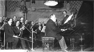 Pierre Monteux - Saint-Saëns at the keyboard, with Monteux (right) on the rostrum, 1913