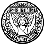 "A circular, black and white logo with a style suggesting late Art Nouveau or early Art Deco. Soroptimist International describes it as follows: ""The emblem consists of a circular disc on which the figure of a woman holds the banner 'Soroptimist' in uplifted arms, spreading sunrays from the background. [From] the banner on one side fall acorns and leaves of oak and on the other side, leaves of laurel. [The] word 'International' completes the outer circle.""[1]"