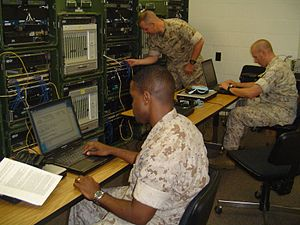 Communications School (United States Marine Corps) - Students planning and configuring multiplexing networks