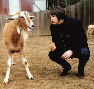 Pet Sounds - Brian Wilson posing with a goat at the San Diego Zoo.
