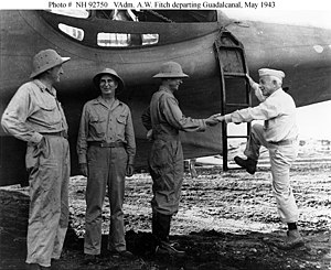 Aubrey Fitch - Vice Admiral Aubrey W. Fitch, USN, Commander, Aircraft, South Pacific Force, boards a PBY-5A aircraft at Guadalcanal (right). c.1943
