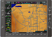 The MFD usually shows engine instrumentation and a moving map.
