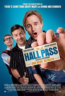 Man holding up a card labelled hall pass, his friends standing behind him