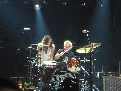 Steven Tyler and Joey Kramer playing drums together at an Aerosmith concert in Chicago, Illinois on June 22, 2012 Steven Tyler Joey Kramer June 2012.jpg