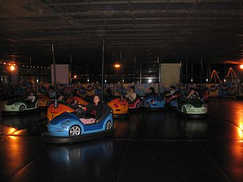 A group of youngsters having fun with bumper cars