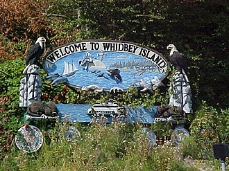 Whidbey Island - Carved sign welcoming visitors as they arrive by ferry at Clinton.