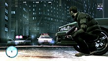 The player character positioned in cover behind a vehicle, preparing to shoot at police officers on the other side of the vehicle.