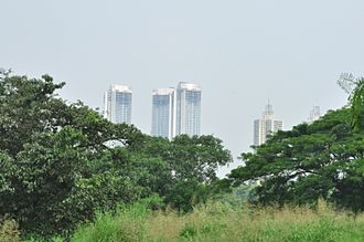 Aarey Milk Colony - Aarey, a green belt zone (foreground) in contrast with the high-rises of Goregaon suburb (background)
