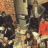 Evans (behind Starr in red jacket) on the Apple Records' roof during filming for Let It Be.