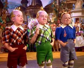 "Munchkin - The Munchkins (specifically the ""Lollipop Guild"") as depicted in the 1939 film The Wizard of Oz.  L-R: Jackie Gerlich, Jerry Maren and Harry Doll"