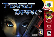 "A red headed woman's face occupies the foreground on an industrial-style background. She is holding a gun. A grey alien is visible at the bottom right corner. In the bottom of the image, the title ""Perfect Dark"" featuring a double slash symbol after the word ""Dark"". Rareware, Nintendo's Seal of Quality, BBFC's rating of ""18"", and Dolby's surround sound logos are shown at the bottom left corner. On the right side of the image, game specifications."