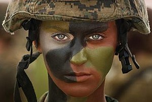 Part of Me (Katy Perry song) - Perry featured in military camouflage, signaling her final transformation into a Marine