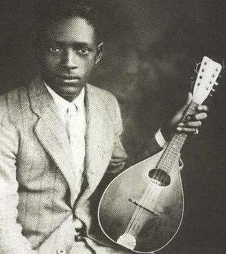 "Papa Charlie McCoy - Portrait of ""Papa"" Charlie McCoy with his mandolin."