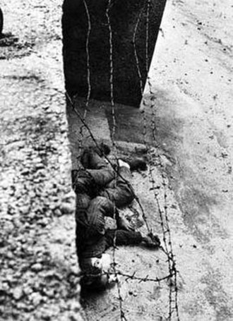 Eastern Bloc emigration and defection - The body of East German Peter Fechter lying next to the Berlin Wall just after being shot in 1962 while trying to escape to the west