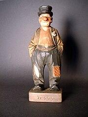 Wood carving of a hobo by Carl Johan Trygg
