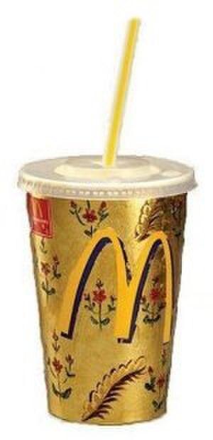 Darío Escobar - Untitled (McDonald's Cup) by Darío Escobar, 1999, cardboard, plastic, gold and pigments