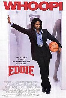 Woman wearing a suit and holding a basketball under her arm