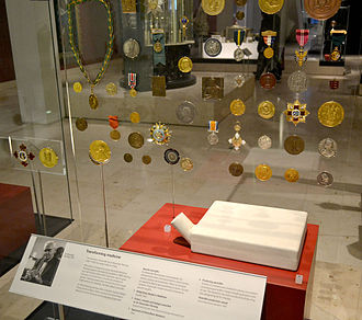 Alexander Fleming - Display of Fleming's awards, including his Nobel Prize. Also shows a sample of penicillin and an example of an early apparatus for preparing it.