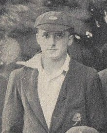A man in a cricket cap and blazer