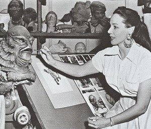 Gill-man - Milicent Patrick, adding some final touches to Ricou Browning's underwater Gill-man mask.