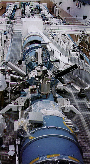 Novette laser - The Novette target chamber (metal sphere with diagnostic devices sticking out), which was reused from the Shiva project and two newly built laser chains visible in background.
