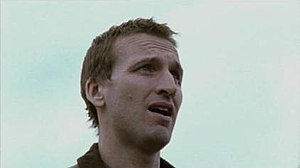 The Second Coming (TV serial) - Steven Baxter (Christopher Eccleston) addresses the crowd who have come to worship him outside the police station in the first episode.