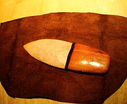 An Northern Ute Ceremonial Knife made from white quartz and Western Cedar wood. These knives were used to cut the umbilical cord of a newborn infant or to harvest sweetgrass and other sacred herbs for ceremonies.