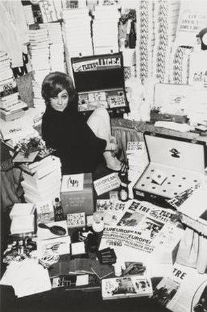 Fluxus - Willem de Ridder's Mail Order FluxShop, Amsterdam, with Dorothea Meijer, winter 1964–65. Photo by Willem de Ridder