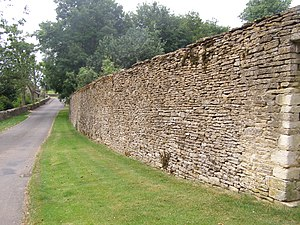 Beverston - A portion of the perimeter wall around Beverston Castle looking south toward the A4135 road, Beverston