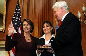 Jim Moran - Moran, accompanied by his wife, LuAnn Bennett, being sworn into a tenth term in the House of Representatives by Speaker Nancy Pelosi in 2007.