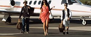 "Best Behaviour (N-Dubz song) - From left to right: Fazer, Tulisa and Dappy exiting a private jet with Louis Vuitton luggage in the extended version of the music video for ""Best Behaviour""."