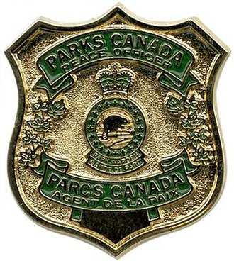 Parks Canada - A Parks Canada Park Warden badge.
