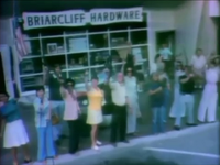 People brandishing firearms outside a hardware store