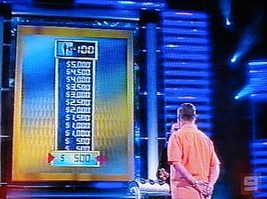 "1 vs. 100 (Australian game show) - The big screen displaying ""Knock Out"" rewards for eliminating each subsequent member of the mob, and the number of mob members remaining."