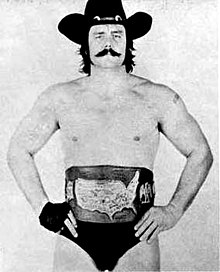 Blackjack Mulligan with a championship belt.jpg