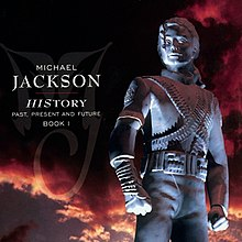 "A image of a silver statue wearing a military-like outfit with its hair clipped behind its head. To the left of the statue the words ""MICHAEL JACKSON"" are written in white letters and underneath them is ""HISTORY PAST PRESENT AND FUTURE BOOK I"" written in smaller white print. Behind the statue, a sky with black and red clouds can be seen."