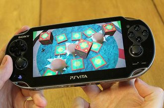 Tearaway (video game) - Players use the rear touch panel to give the effect of pushing their fingers through the game world.